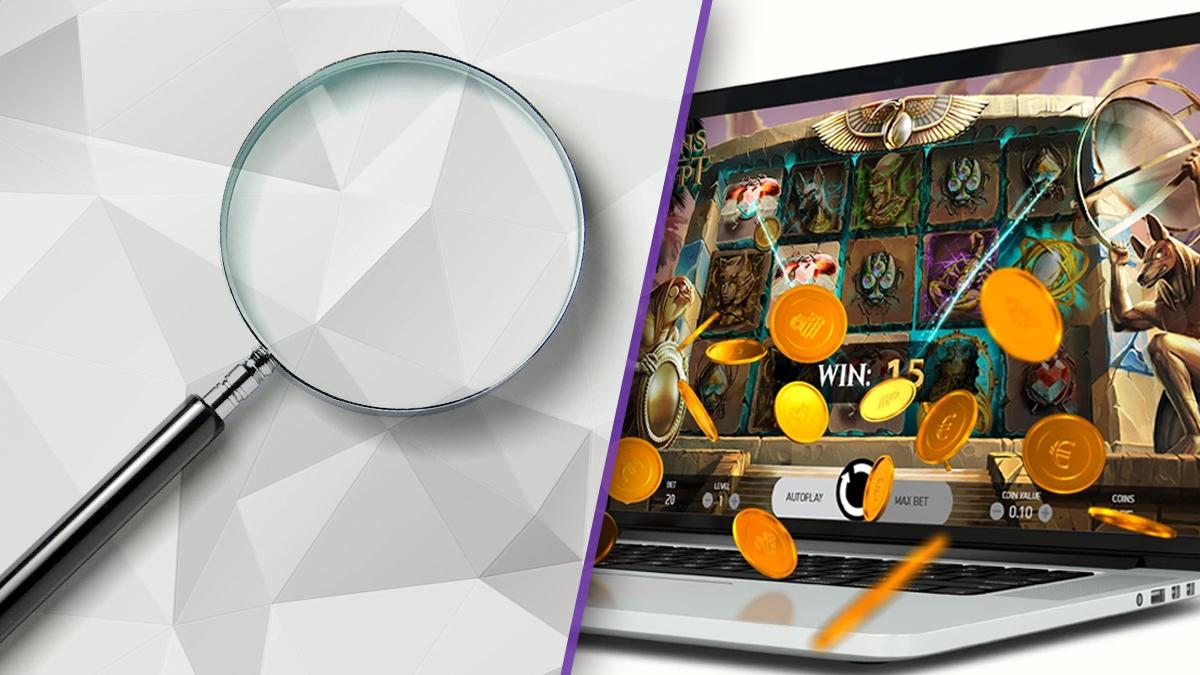 Lupe und Online-Slots auf dem Laptop